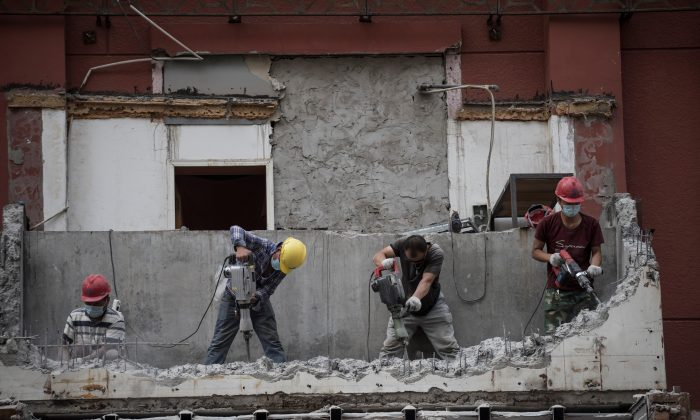 Chinese laborers work on a construction site in Beijing on June 21, 2017.  (Fred Dufour/AFP/Getty Images)