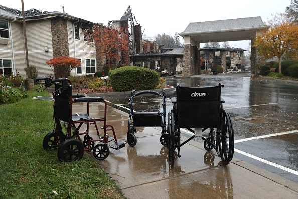 Wheelchairs sit in front of a senior living facility that was destroyed by the Camp Fire in Paradise