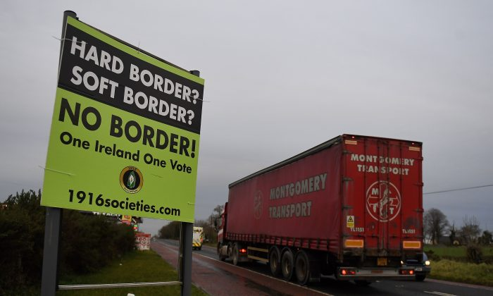 FILE PHOTO: A sign for 'No border' is seen on the border between Northern Ireland and Ireland in Jonesborough, Northern Ireland December 10, 2018. REUTERS/Clodagh Kilcoyne/File Photo