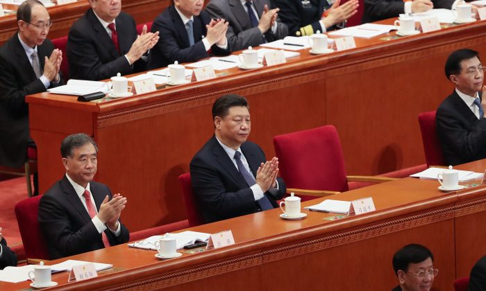 BEIJING, CHINA - MARCH 05:  Chinese President Xi Jinping claps hands at Chinese Premier Li Keqiang's speech during the opening of the Two Sessions of the 13th National People's Congress (NPC) at The Great Hall of the People on March 5, 2019 in Beijing, China.  (Photo by Andrea Verdelli/Getty Images)