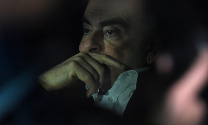 Former Nissan chairman Carlos Ghosn leaves his lawyers' offices after he was released earlier in the day from a detention centre after posting bail in Tokyo on March 6, 2019. - Former Nissan chief Carlos Ghosn left his Tokyo detention centre on March 6 after more than 100 days in custody, following a shock court decision granting him bail of one billion yen ($9 million). (Photo by Kazuhiro NOGI / AFP)        (Photo credit should read KAZUHIRO NOGI/AFP/Getty Images)