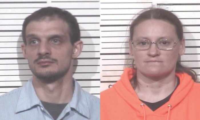 Mark Lee Pierce and Jessica Woodworth of Paris, Tenn., were arrested on suspicion of child abuse and aggravated assault when an Olive Garden waitress observed them behaving strangely and called the police on March 3. (Paris Police Department)