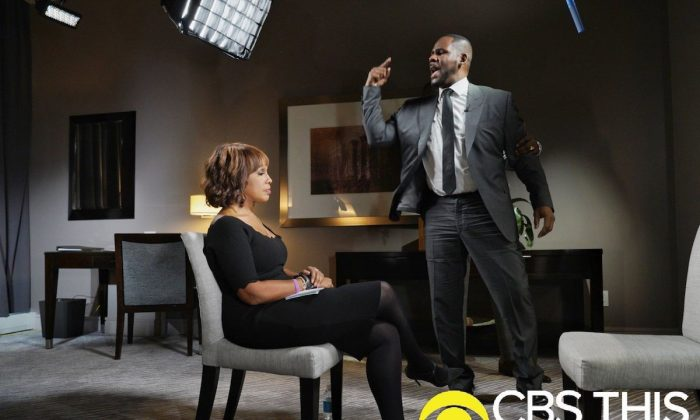 """R&B singer R. Kelly gestures while making a point during an interview with Gayle King on """"CBS This Morning"""" broadcast. On March 5, 2019. (Lazarus Jean-Baptiste/CBS via AP)"""