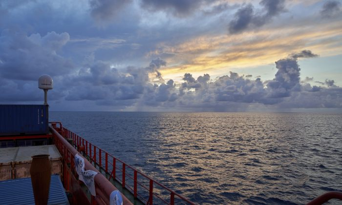 Sun rises near the tiny atoll of Alphonse where scientists onboard the Ocean Zephyr began exploring the depths of the Indian Ocean, Thursday March 7, 2019. The expedition is led by the Britain-based Nekton, an independent, non-profit research institute that works with the University of Oxford to increase scientific understanding of the oceans. (AP Photo/David Keyton)