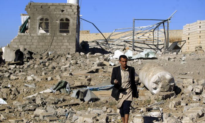 A Yemeni man walks in the ruins of a building destroyed in Saudi-led air strikes in Yemen's capital Sanaa on Feb. 1, 2019. (MOHAMMED HUWAIS/AFP/Getty Images)