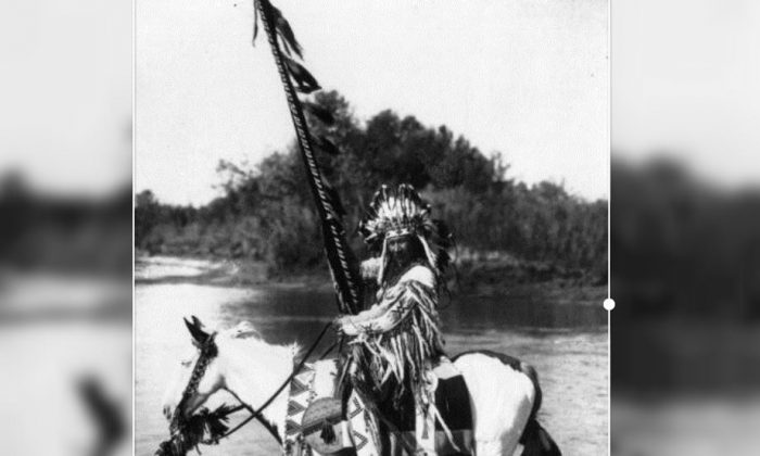 A chief of the Blackfoot tribe on horse-back and wearing traditional dress and headdress, in western Canada. (Spencer Arnold Collection/Hulton Archive/Getty Images)
