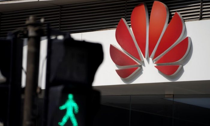 A Huawei company logo is seen outside a shopping mall in Shanghai, China on March 7, 2019. (Aly Song/Reuters)