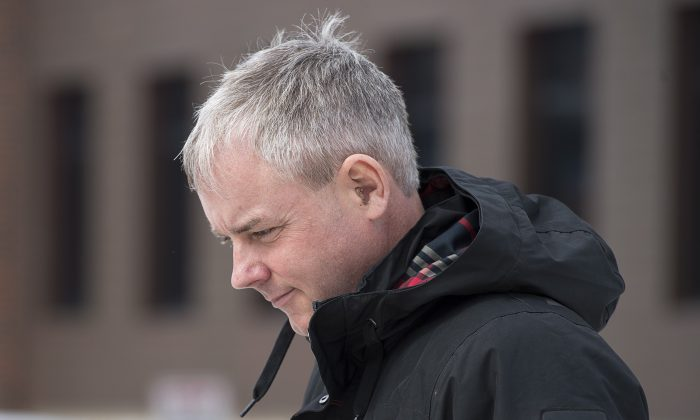 Dennis Oland heads from the Law Courts as he continue his testimony in Saint John, N.B., on March 7, 2019. (Andrew Vaughan/The Canadian Press)