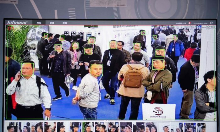 A screen shows visitors being filmed by AI (artificial intelligence) security cameras with facial recognition technology at the 14th China International Exhibition on Public Safety and Security at the China International Exhibition Center in Beijing on October 24, 2018. (NICOLAS ASFOURI/AFP/Getty Images)