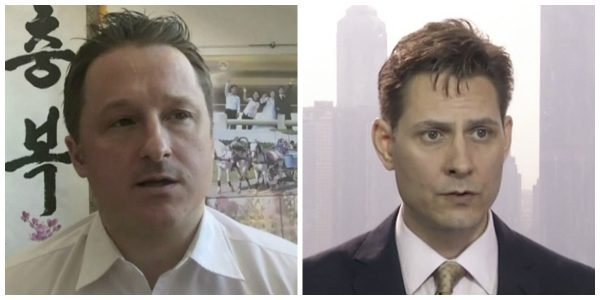 Canadians Michael Spavor (L) and Michael Kovrig