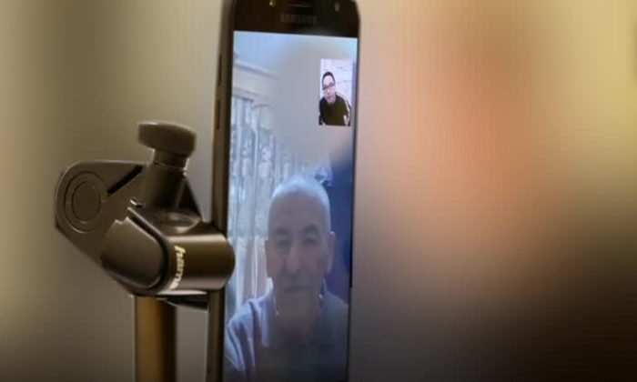 Uyghur Tahir Mutallip Qahiri receives a call from his father, a prominent retired Uyghur scholar and professor in Xinjiang, after they had been out of contact for 17 months. (Tahir Qahiri)