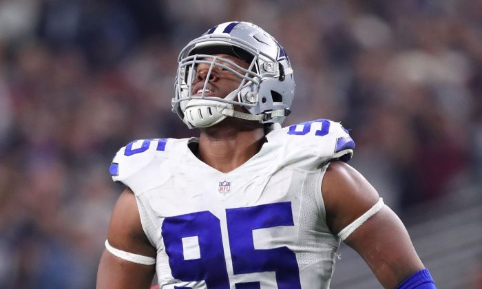 David Irving #95 of the Dallas Cowboys celebrates after sacking Jameis Winston #3 of the Tampa Bay Buccaneers during the fourth quarter at AT&T Stadium in Arlington, Texas, on Dec. 18, 2016. (Tom Pennington/Getty Images)
