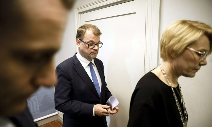 Finnish Prime Minister Juha Sipila walks during an announcement of his government's resignation at his official residence in Helsinki on March 8, 2019. (Lehtikuva/Seppo Samuli via Reuters)