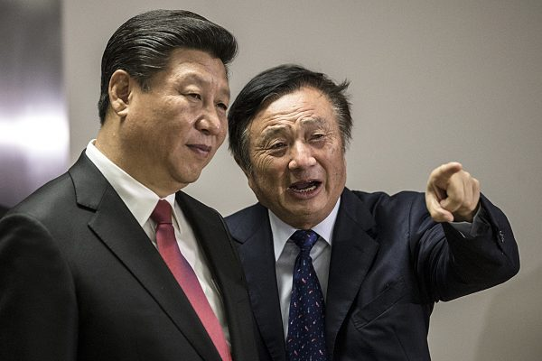 Huawei President Ren Zhengfei (R) shows Chinese leader Xi Jinping around