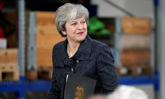 British Prime Minister Theresa May delivers a speech during her visit in Grimsby, United Kingdom, on March 8, 2019. (Christopher Furlong/Pool via Reuters)