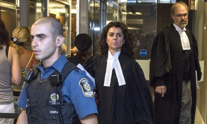 Prosecutors Helene Di Salvo (L) and Guy Bouthillier (R), leave at the Montreal Courthouse on June 21 2012. (ROGERIO BARBOSA/AFP/GettyImages)