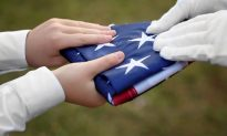 Boy Uses Body as a Shield When Friends Struggle to Fold American Flag on Windy Day