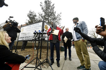 Singer R. Kelly center, speaks to the media while his attorney Steve Greenberg right,