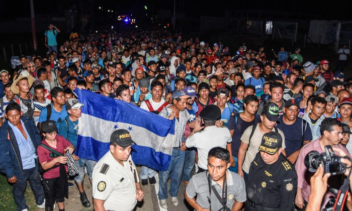 Honduran migrants taking part in a new caravan heading to the US, arrive to Chiquimula, Guatemala, on Oct. 22, 2018. (Orlando Estrada/AFP/Getty Images)