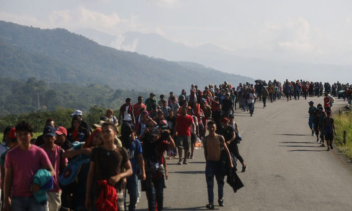 Central American caravan migrants walk along a roadside in Huixtla, Mexico, on their way to the United States on Jan. 20, 2019. (Mario Tama/Getty Images)