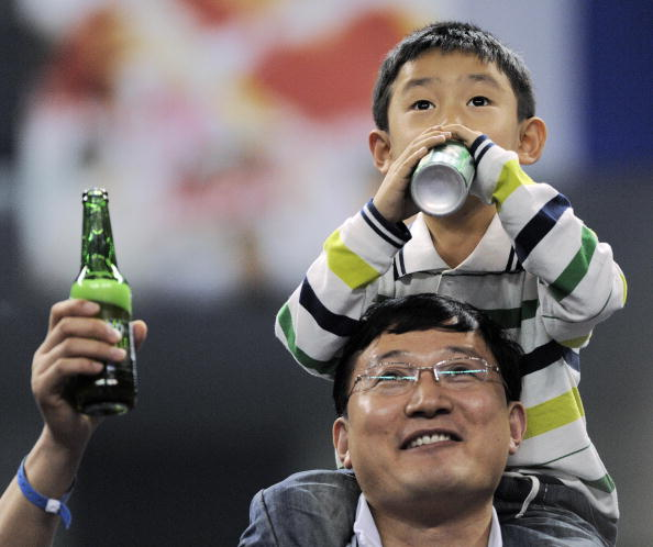 Man and boy drinking