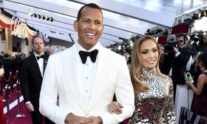 Alex Rodriguez, left, and Jennifer Lopez arrive at the Oscars at the Dolby Theatre in Los Angeles on Feb. 24, 2019. (Charles Sykes/Invision/AP)
