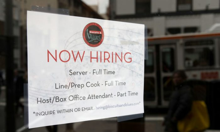 A now-hiring sign is posted at a restaurant in San Francisco, California, on Feb. 12, 2019.  (Justin Sullivan/Getty Images)