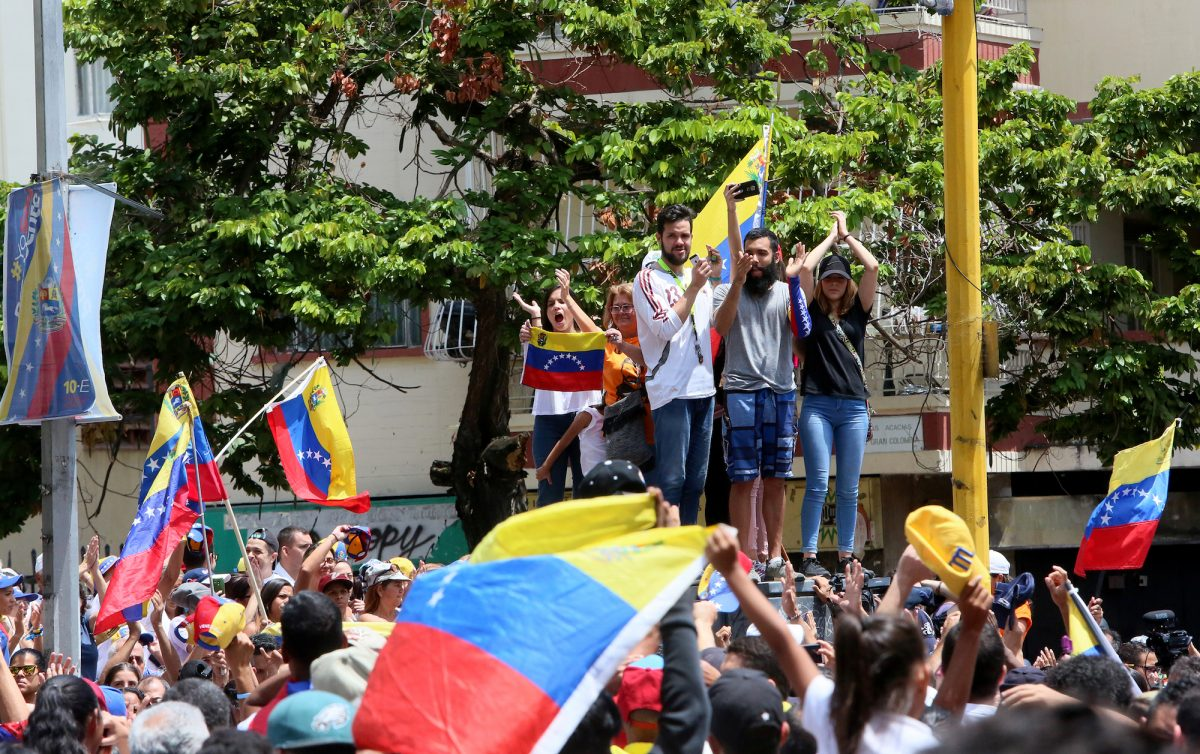 Venezuelans take part in a protest against the Maduro regime