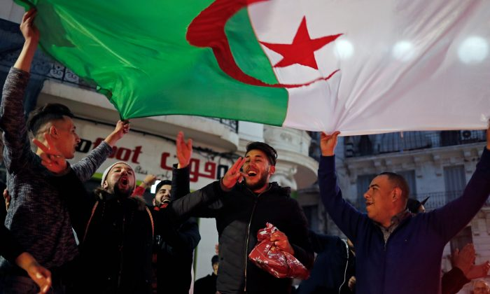 People celebrate on the streets after President Abdelaziz Bouteflika announced he will not run for a fifth term, in Algiers, Algeria March 11, 2019. REUTERS/Zohra Bensemra