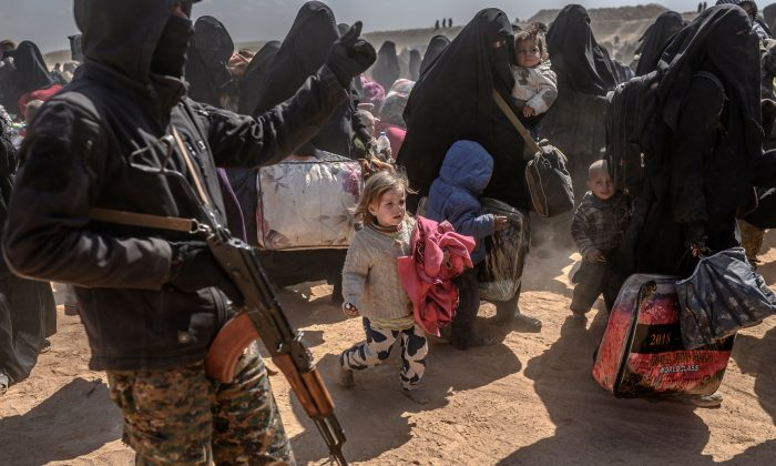 Women and children evacuated from the ISIS terror group's embattled holdout of Baghouz arrive at a screening area held by the US-backed Kurdish-led Syrian Democratic Forces (SDF), in the eastern Syrian province of Deir Ezzor, on March 6, 2019. (Bulent KILIC / AFP)