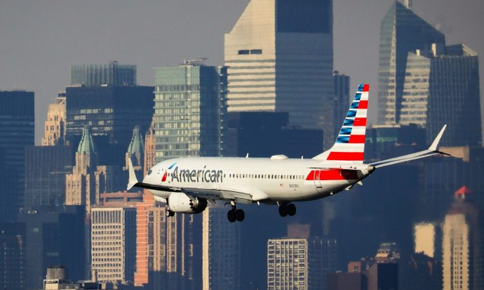 An American Airlines Boeing 737 Max 8, on a flight from Miami to New York City, lands at LaGuardia Airport in the Queens borough of N.Y.C., on March 11, 2019. (Drew Angerer/Getty Images)