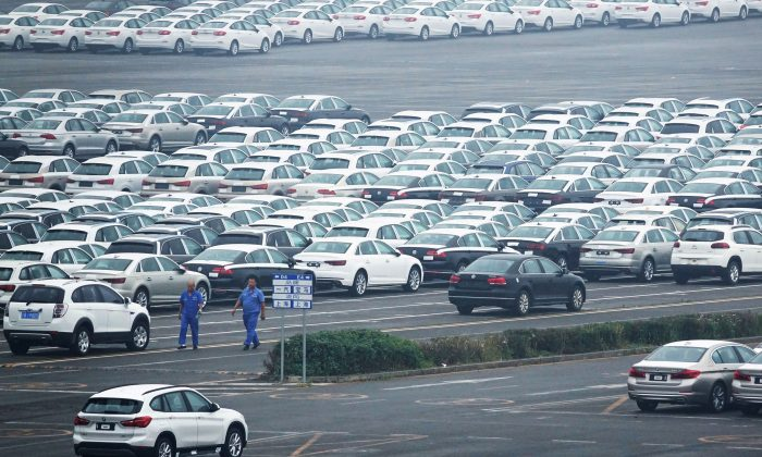 Newly manufactured cars are seen at the automobile terminal in the port of Dalian, Liaoning Province, China on July 9, 2018.  (Reuters)