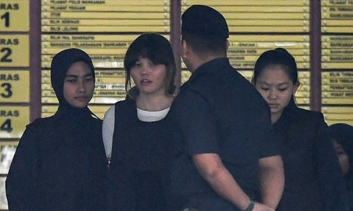 Royal Malaysian Police escort Vietnamese defendant Doan Thi Huong (2nd L) after her trial at the Shah Alam High Court in Shah Alam, outside Kuala Lumpur on Oct. 2, 2017, for her alleged role in the assassination of Kim Jong-Nam, the half-brother of North Korean leader Kim Jong. (Mohd Rasfan/AFP/Getty Images)