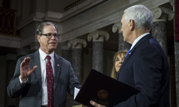 Sen. Mike Braun (R-Ind.) participates in a mock swearing in ceremony with Vice President Mike Pence on Capitol Hill in Washington on Jan. 3, 2019. (Zach Gibson/Getty Images)