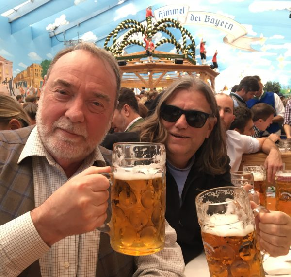R. DeSalle and I. Tattersall hold pints of beer at Oktoberfest