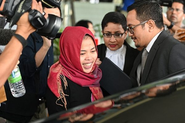 Indonesian national Siti Aisyah (C) smiles while leaving the Shah Alam High Court,