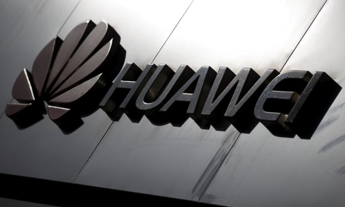 The Huawei brand logo is seen above a store of the telecoms equipment maker in Beijing on March 7, 2019. (Thomas Peter/Reuters)