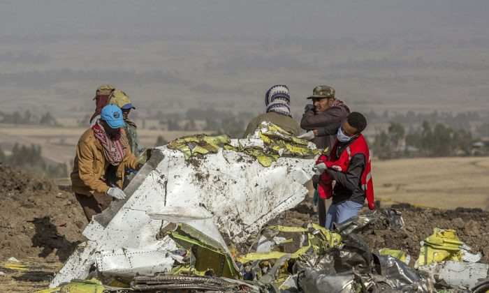 Rescuers work at the scene of an Ethiopian Airlines flight crash near Bishoftu, or Debre Zeit, south of Addis Ababa, Ethiopia, on March 11, 2019. (Mulugeta Ayene/AP Photo)
