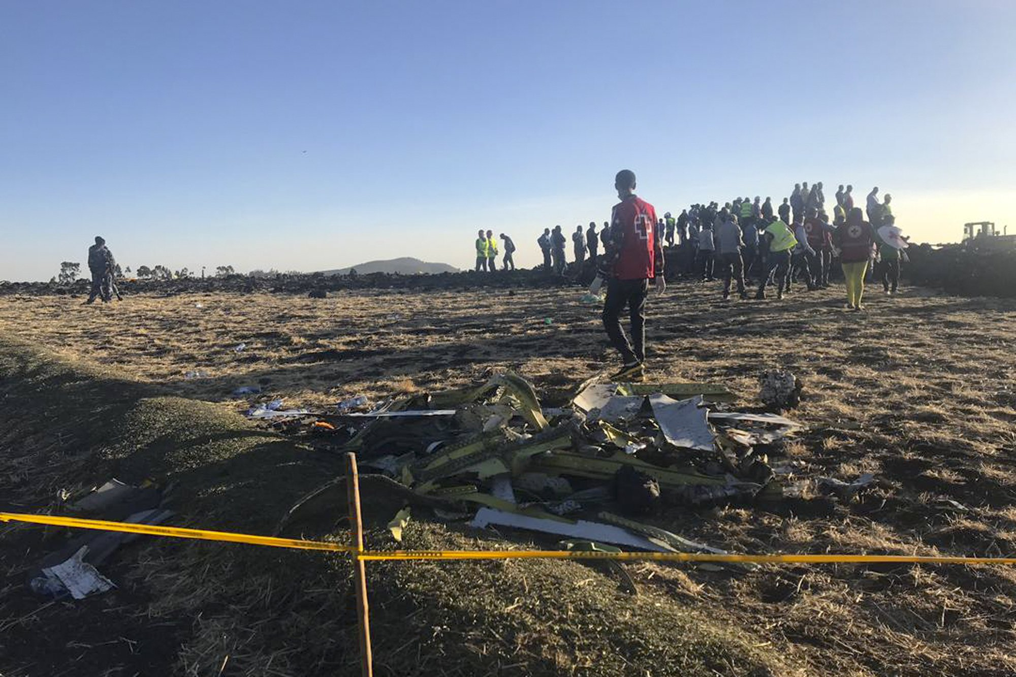 Rescuers search at the scene of an Ethiopian Airlines flight
