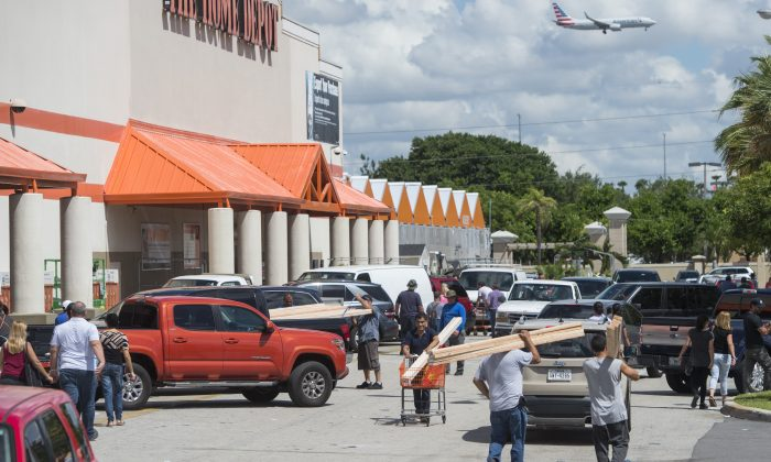 People leave with supplies outside a Home Depot store in Miami, Florida, as they prepare for Hurricane Irma, on Sept. 7, 2017.        (Saul Loeb/AFP/Getty Images)