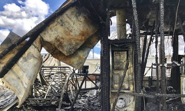 The burned out remains of a mobil home that caught fire in the Highland area of San Bernardino County, on March 9, 2019. (Cal Fire San Bernardino via AP)