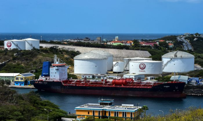 An oil tanker remains docked in front of Isla oil refinery, which is leased by Venezuelan state oil company PDVSA in Willemstad, Curacao, Netherlands Antilles, on Feb. 22, 2019. (LUIS ACOSTA/AFP/Getty Images)
