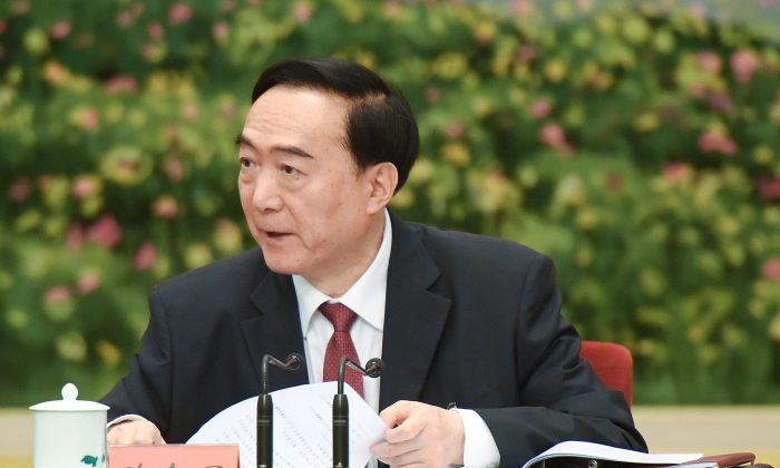 "Chen Quanguo, CCP secretary of Xinjiang, attends a meeting of the 19th Communist Party Congress at the Great Hall of the People on October 19, 2017 in Beijing, China. Chen developed the so-called ""vocational education centres"" that detains million of Uighurs and other Muslim minorities.  (Etienne Oliveau/Getty Images)"
