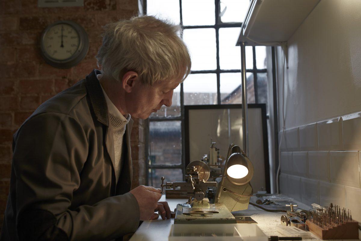 Man makes watch in workshop
