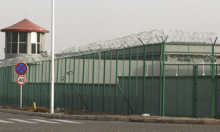 "A guard tower and barbed wire fences surround an internment facility in the Kunshan Industrial Park in Artux in western China's Xinjiang region on Dec. 3, 2018. A U.S. envoy on religion has described China's internment of an estimated 1 million Muslims as a ""horrific situation."" Ambassador-at-large Sam Brownback called for an independent investigation into the detentions and the release of those being held. (Ng Han Guan/AP)"