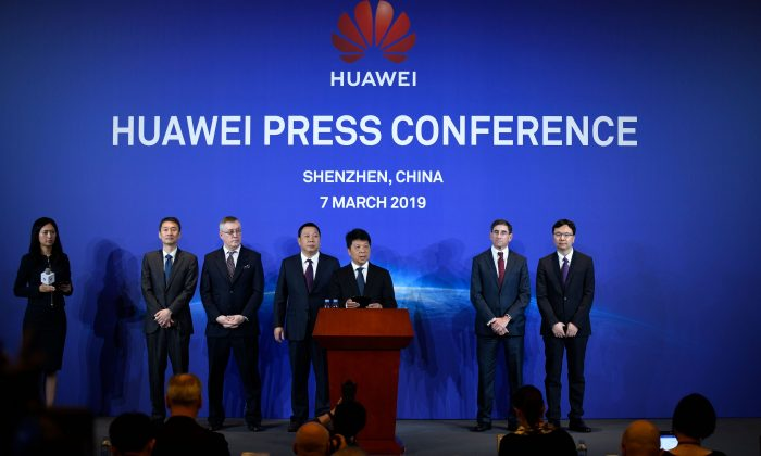 Huawei's rotating Chairman Guo Ping (C) speaks during a press conference in Shenzhen, China's Guangdong Province on March 7, 2019. Huawei said on March 7 it was suing the United States for barring government agencies from buying the telecom company's equipment and services. (Wang Zhao/AFP/Getty Images)