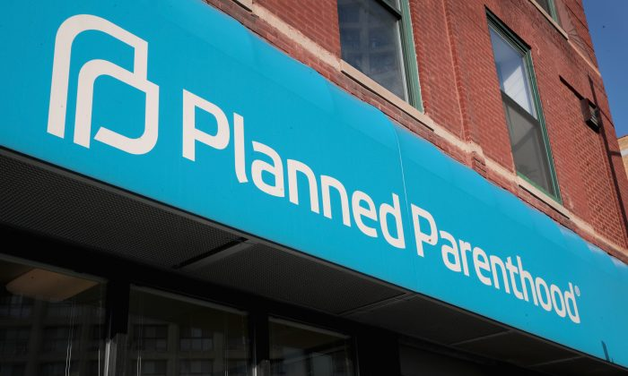 A sign hangs above a Planned Parenthood clinic in Chicago, Ill., on May 18, 2018. (Scott Olson/Getty Images)