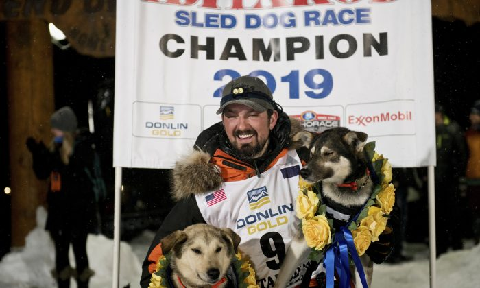 Peter Kaiser (9) poses with his lead dogs, Morrow, left, and Lucy, on March 13, 2019, in Nome, Alaska. (Marc Lester/Anchorage Daily News via AP)