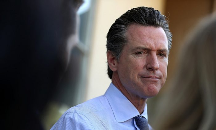 Democratic California Gov. Gavin Newsom talks with reporters in Larkspur, Calif., on June 5, 2018. (Justin Sullivan/Getty Images)