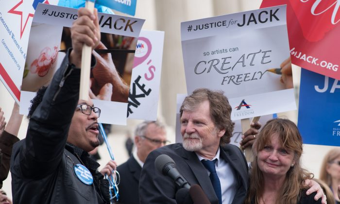 Jack Phillips, owner of Masterpiece Cake in Colorado, stands with supporters outside the US Supreme Court after Masterpiece Cakeshop vs. Colorado Civil Rights Commission were heard on December 5, 2017 in Washington, DC. MARI MATSURI/AFP/Getty Images)